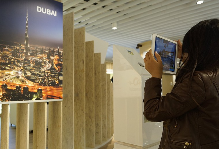 Dubai Pavilion exhibition visitor making use of the augmented reality app display