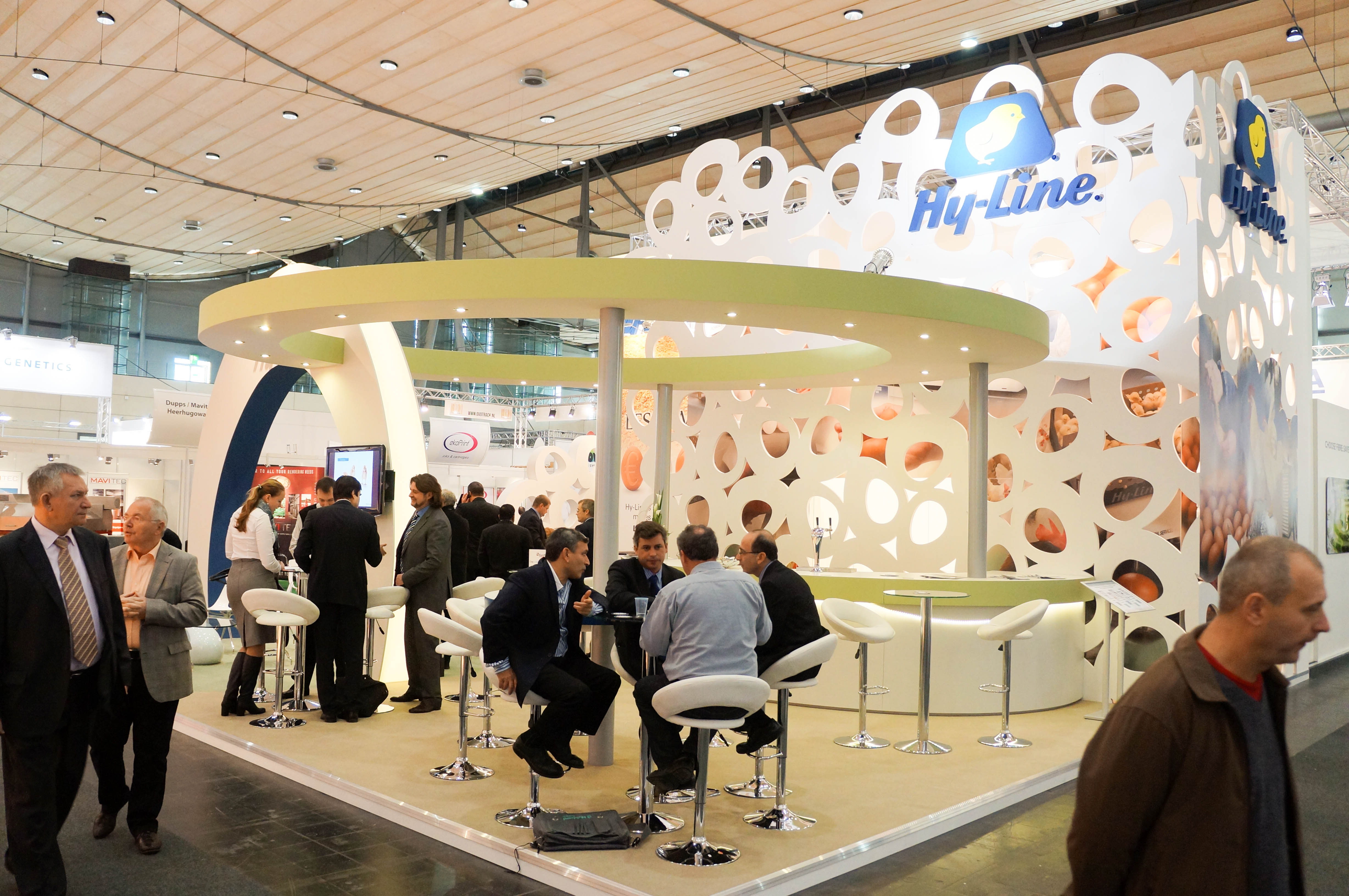 """""""Seating area on the front corner of Hy-Line exhibition stand."""""""